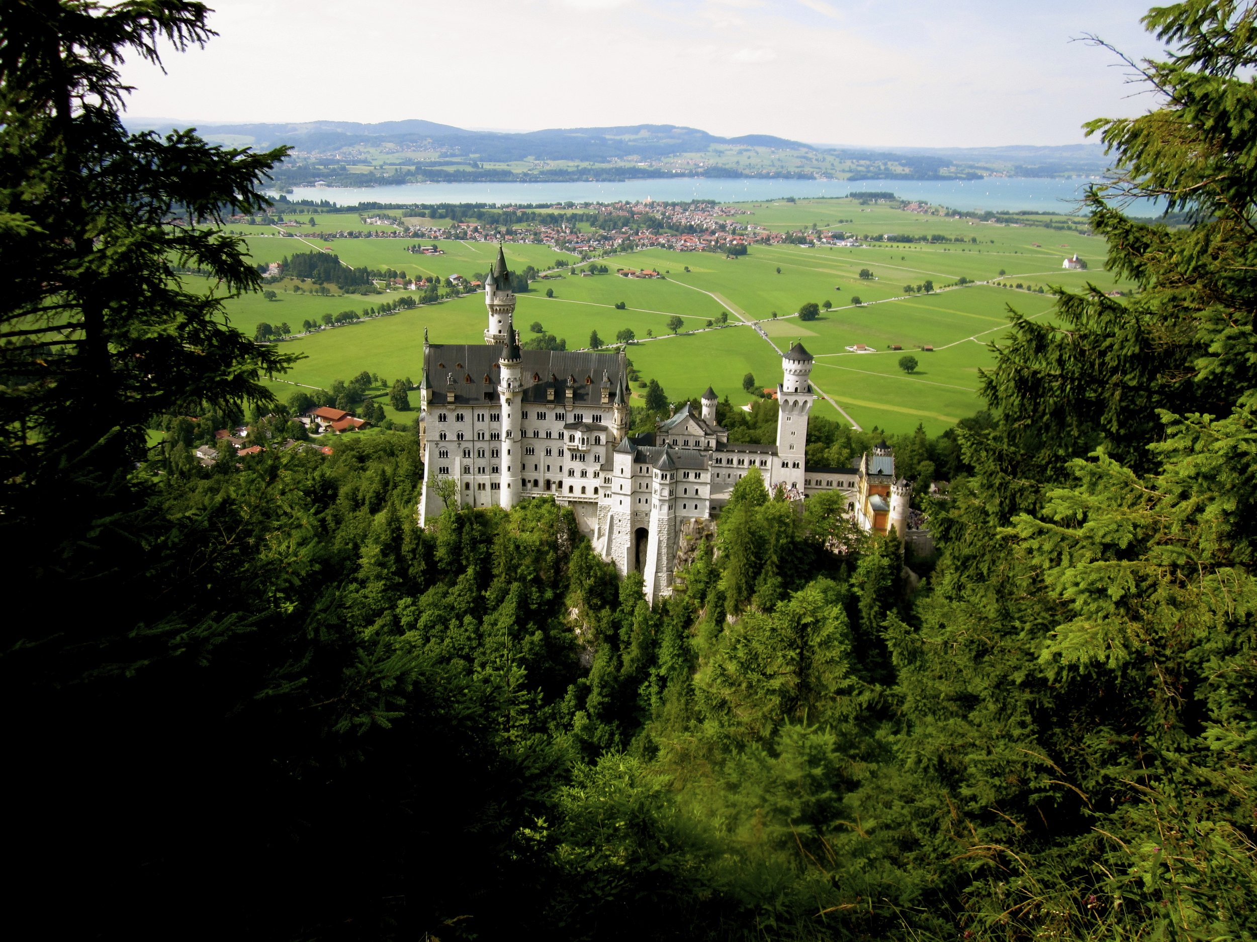 STRAIGHT OUTTA FAIRYTALES - The mountain town of Füssen is home to the famous Neuschwanstein Castle. Does it look familiar? Maybe that's because Walt Disney was so inspired by Neuschwanstein's fairytale design and architecture, he used it to create the Cinderella castle in the cartoon film in the 50's, which led to the inspiration for the Disney logo, as well as the Cinderella Castle at Disneyworld and Disneylands around the world!