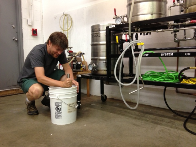Getting the brew ready at New Planet Beer.