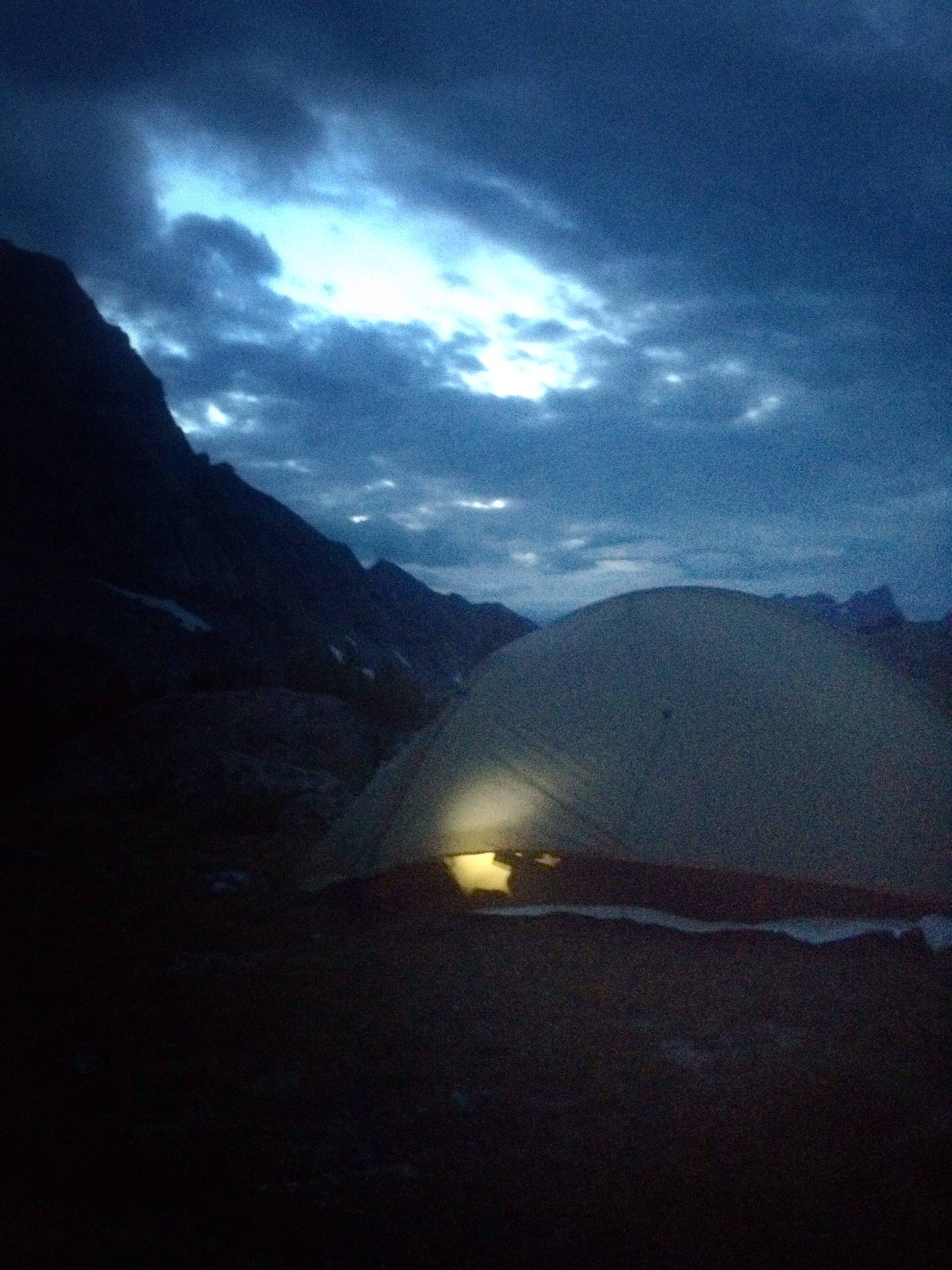 Analog's tent illuminated by headlight as he reviews the coming day's terrain.