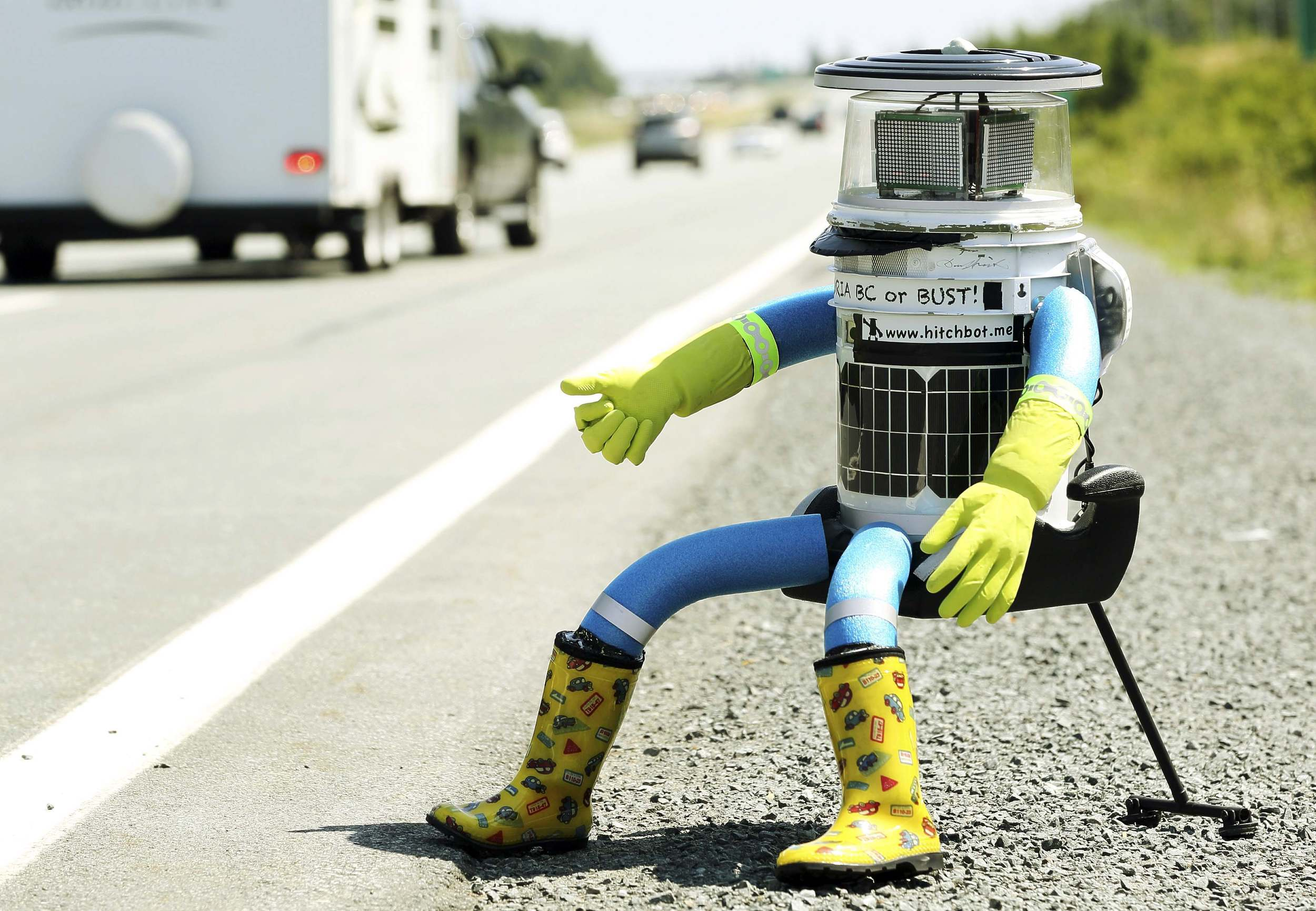 HitchBOT doing what he does best, hitching!
