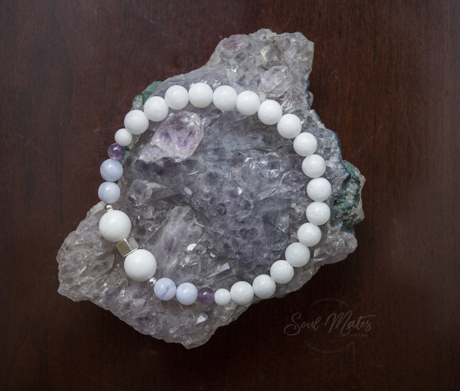 Calming  - Amethyst, Blue Lace Agate and White Jade make up this bracelet to calm the mind and emotions for stress relief during the day or for preparing for a restful night's sleep.  $22