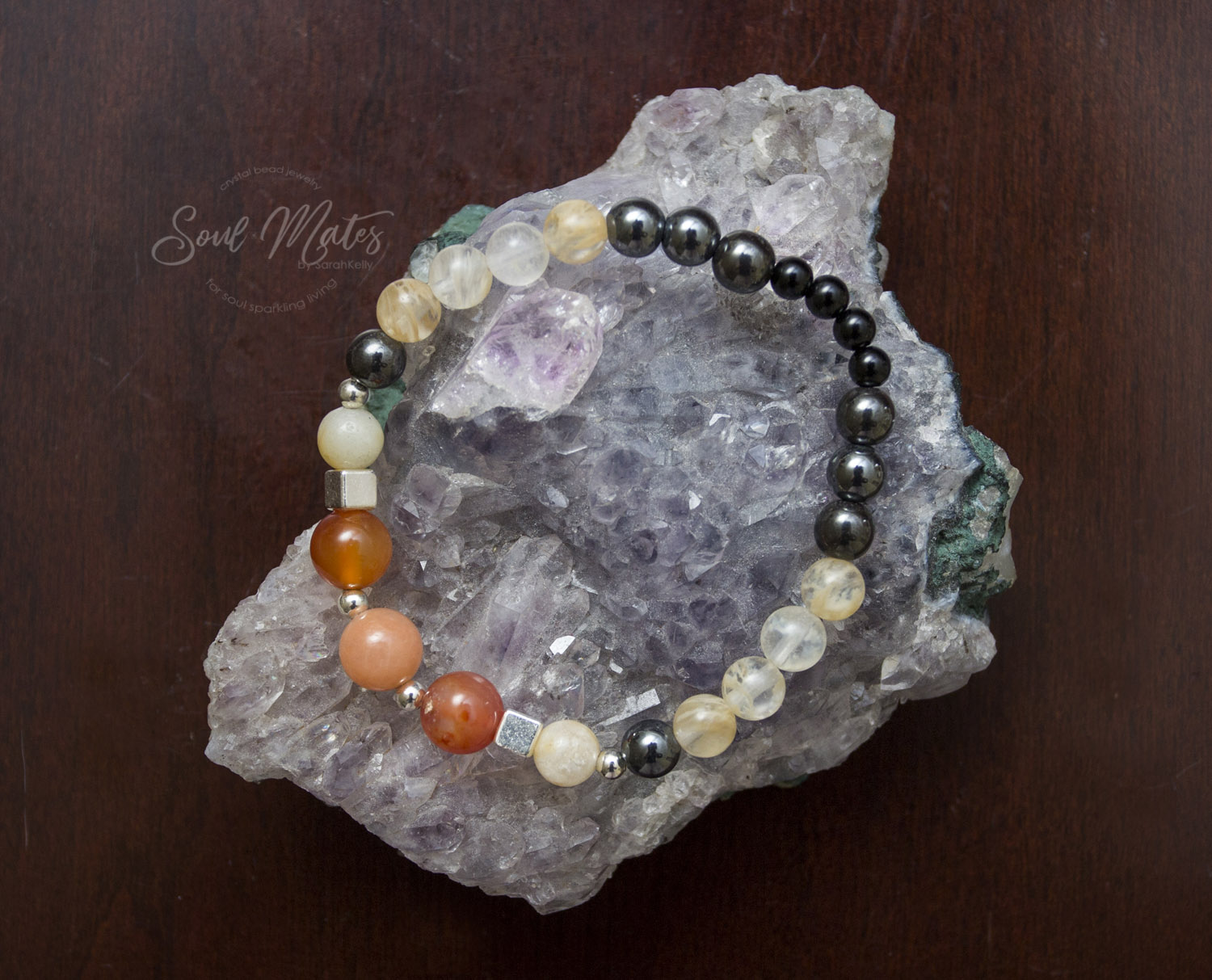 Energizing  - Carnelian, Citrine, grounding Hematite and Onyx for dissolving negativity and restoring peace and harmony in the body. Wealth attracting.  Great for day wear.  $22