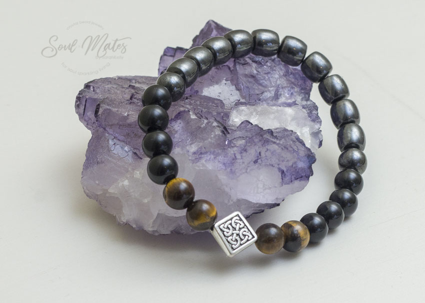 Grounding  - Hematite and Tiger's Eye grounds and protects while offering confidence, abundance and mental willpower.  $20