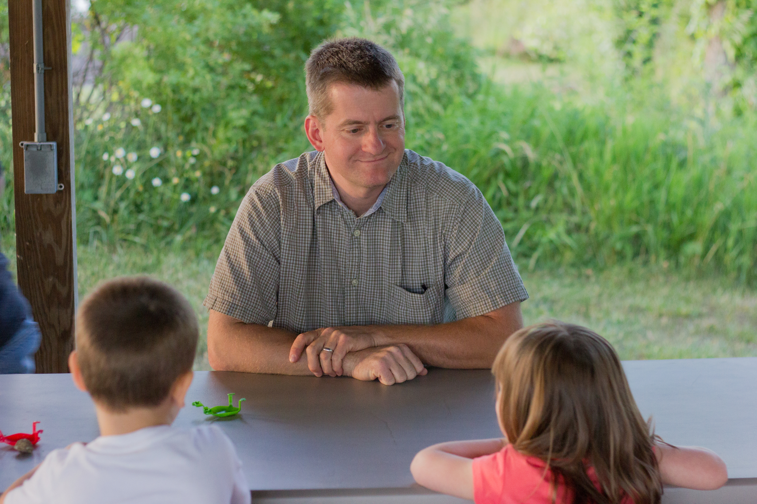 Mark Hall (Deacon) talking to children during a VBS activity