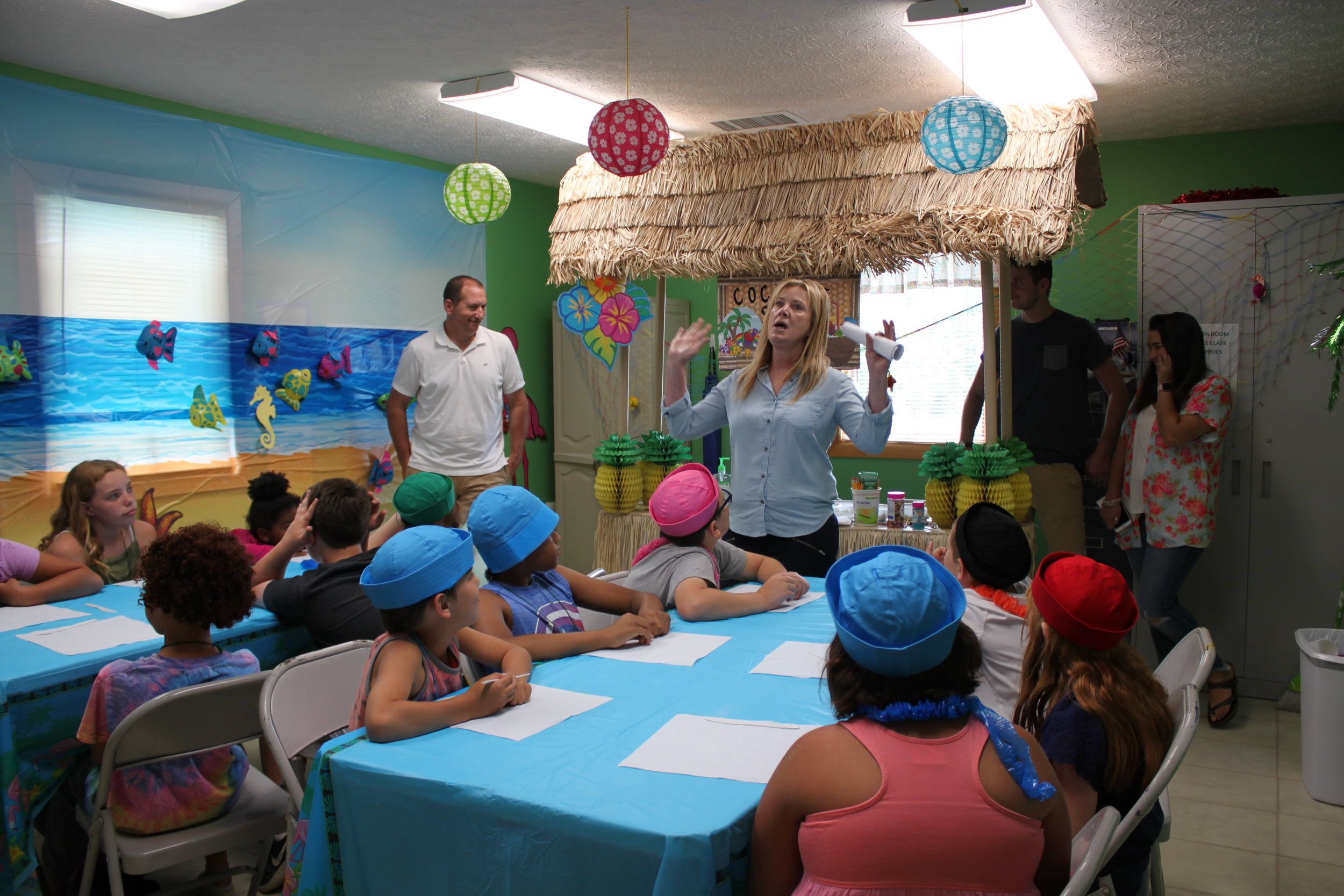 Linda Veltri (member) teaching a class in the 2019 VBS Super Saturday with the assistance of John Vetri, Luke Veltri and Tori Garnes.