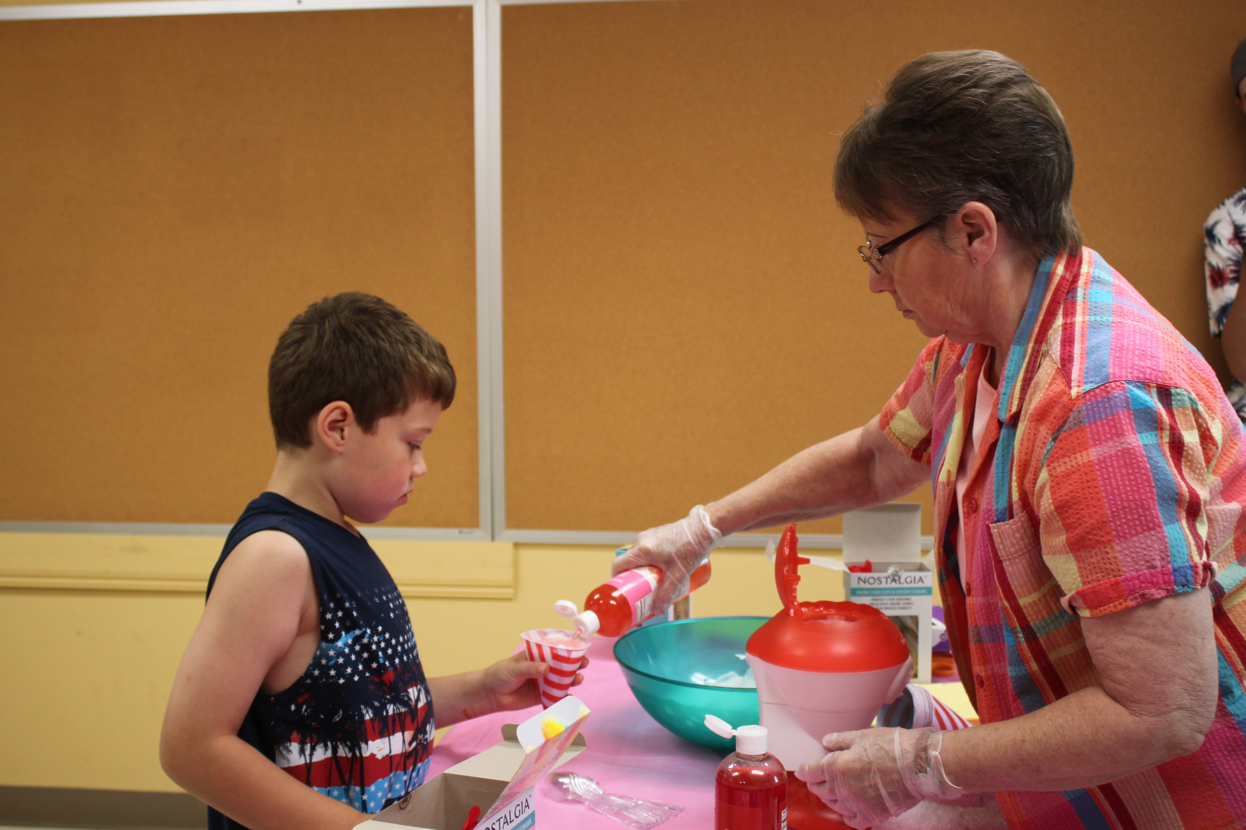 Ice cone treats served at the end of the 2019 VBS Super Saturday to Master Corbin Carney by Mrs Bonnie Massey.