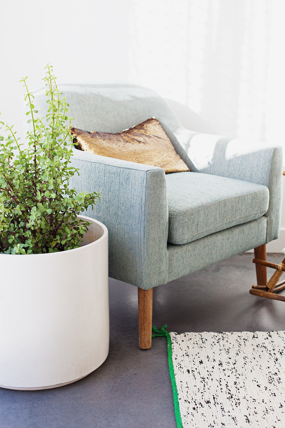 Chair from Houzz, large planter from Let Go, rug from Ikea, sequin pillow from Nordstrom Rack, plant from Home Depot