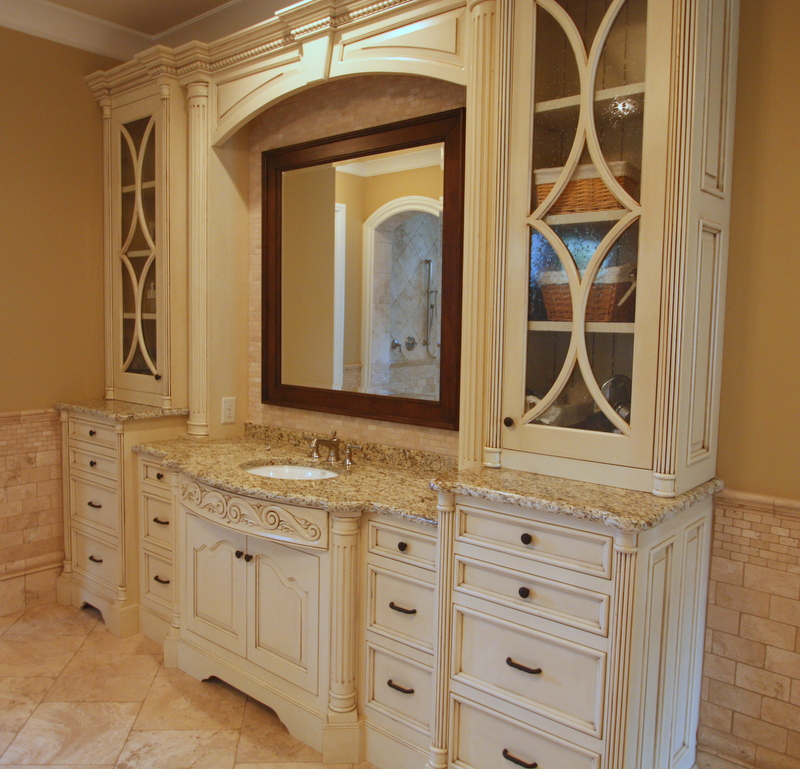 Custom Mirror Frames Set Into Arched Valances with Flanking Seedy Glass Doors