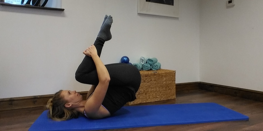 Rolling Back Pilates mat.jpg
