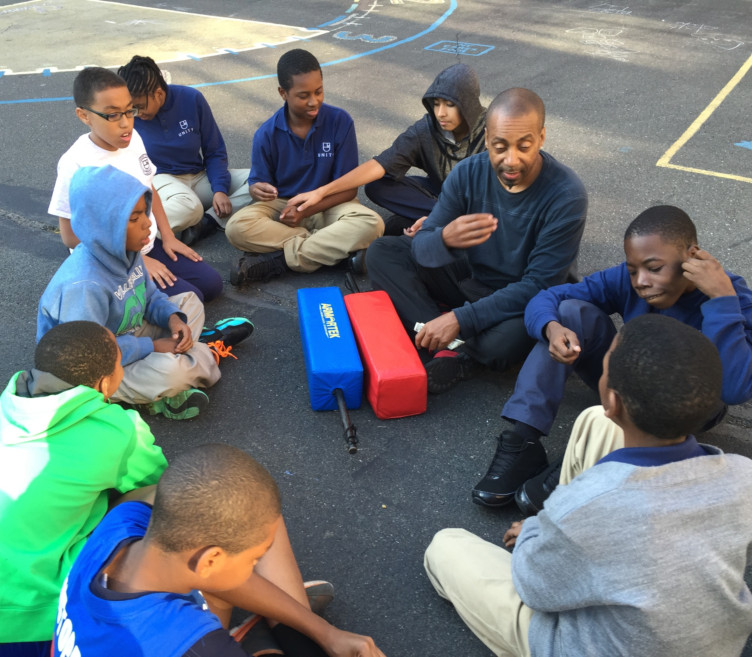 Unity Preparatory charter school - students of the martial arts club discuss and practice breathing techniques.