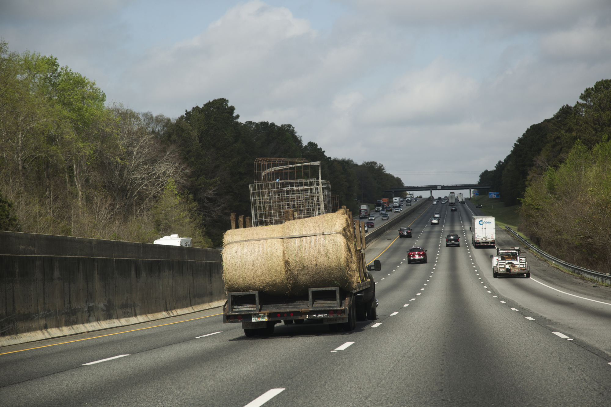 Sammy Busciglio drives a truck loaded with feed troughs, calf pins and bales of hay north on I-75 from Tampa to the new farmland in Gay, Georgia, on March 27, 2017. The new property is 270 acres, and the family hopes to expand their herd.