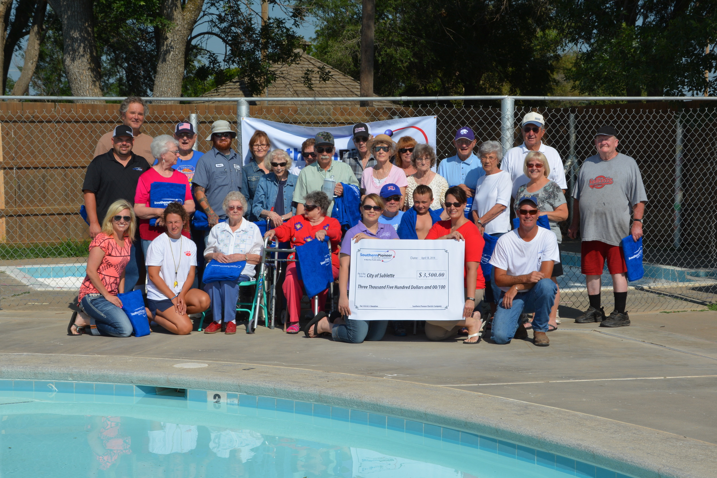 Pictured are H.U.G.S. Team members, City of Sublette employees, Mayor Jery Bailey, senior citizens from the Satanta Nursing Home, and senior citizens from Sublette's Pride of Life.