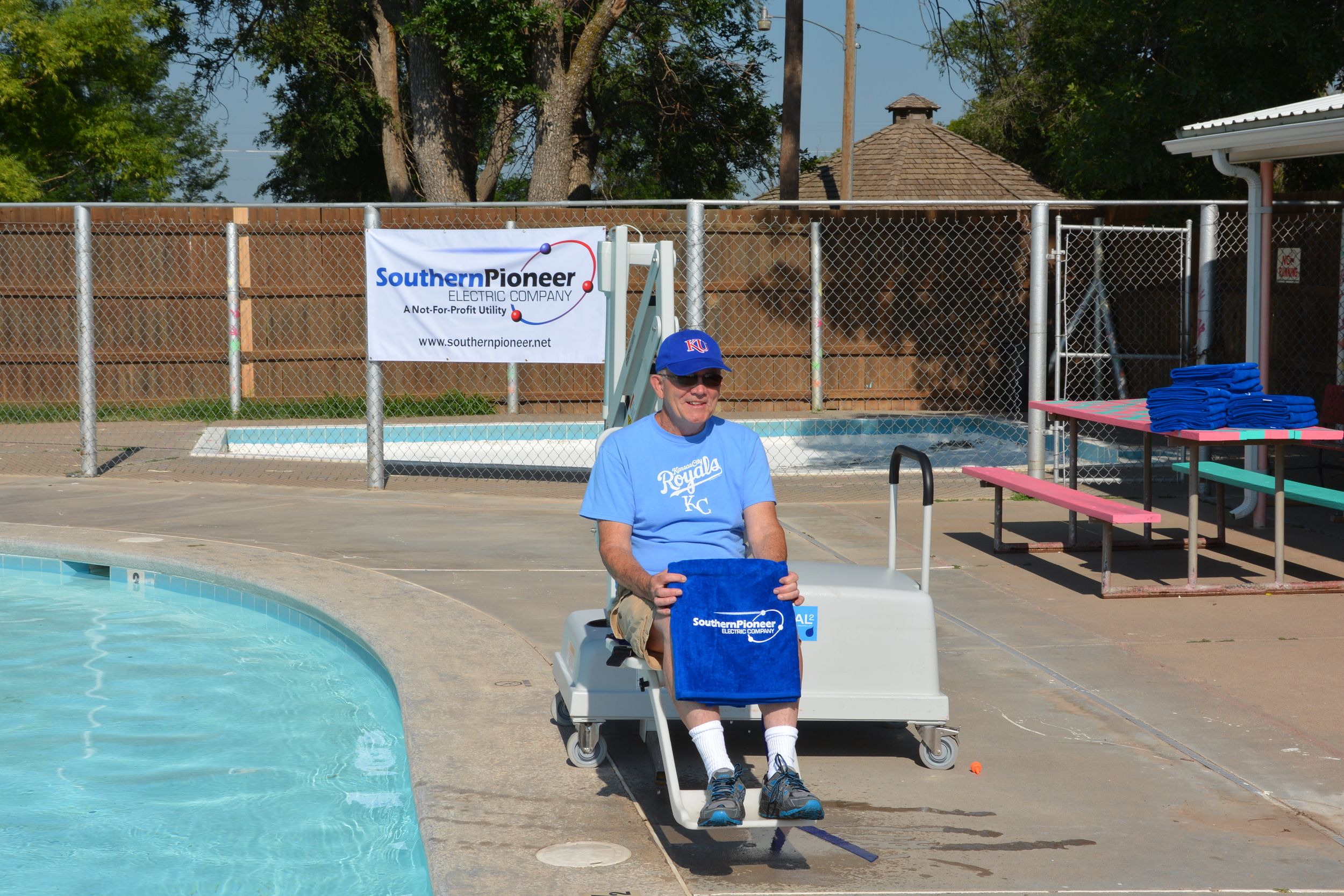 Mayor of Sublette, Jery Bailey- poses for a picture in the new mobile chair lift purchased with H.U.G.S. funds for the Sublette City pool.