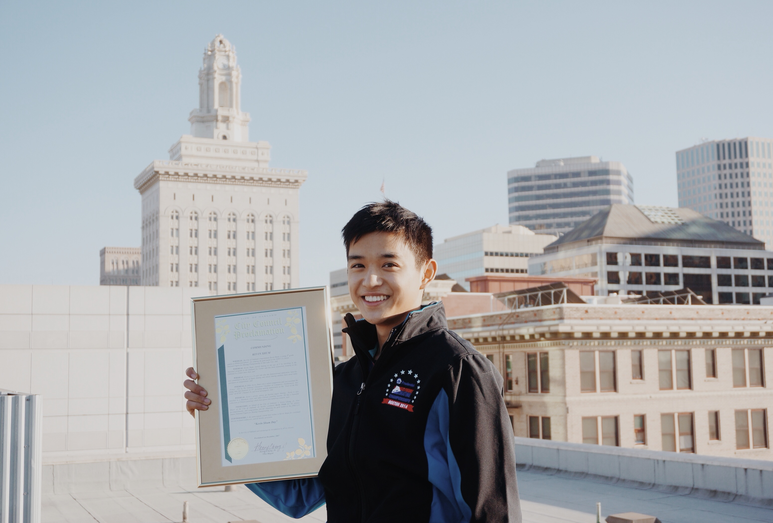 Celebrating Kevin Shum Day on the eve of 2014 in front of Oakland's City Hall