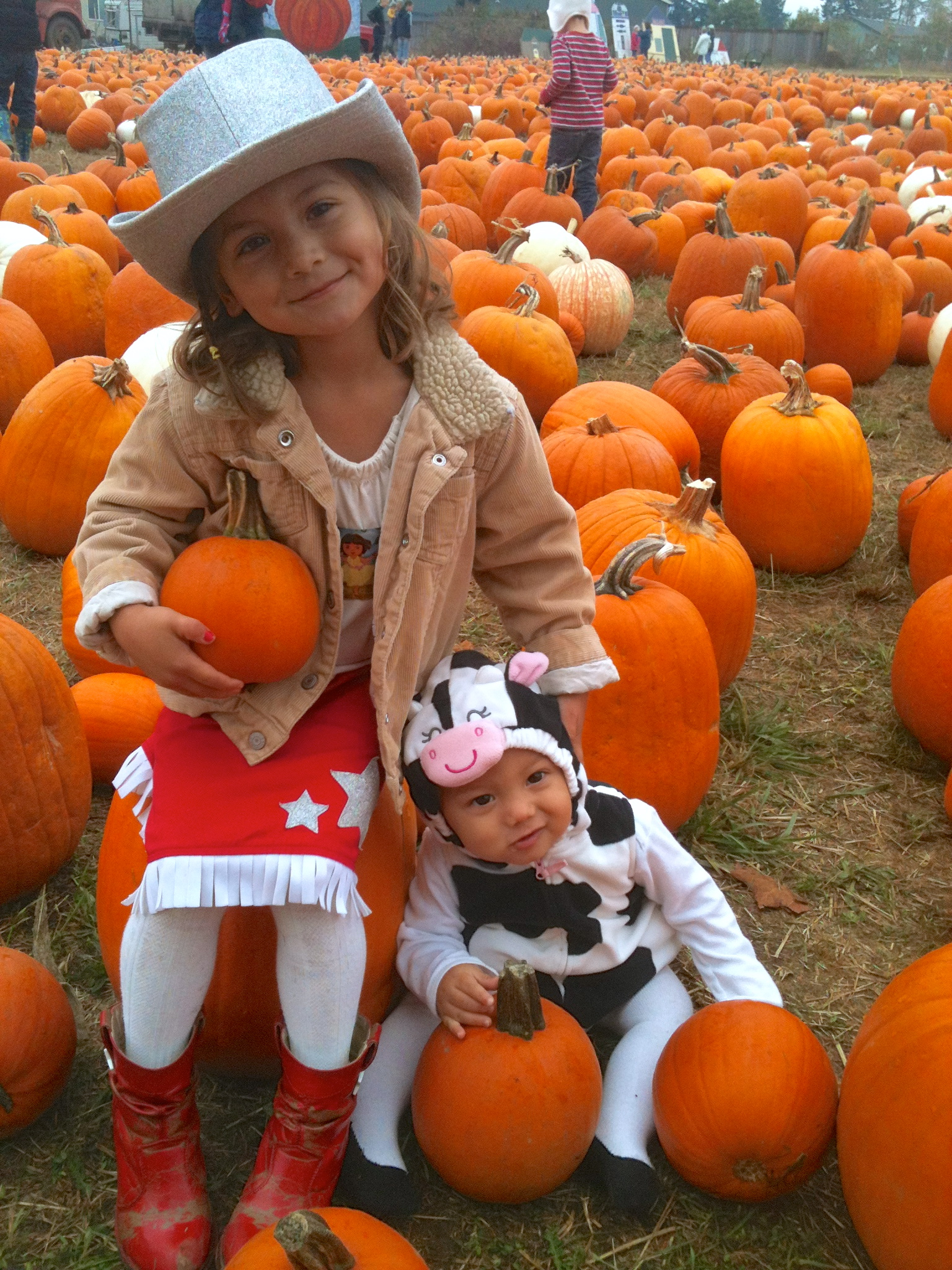 Our little ones at the pumpkin patch last year.