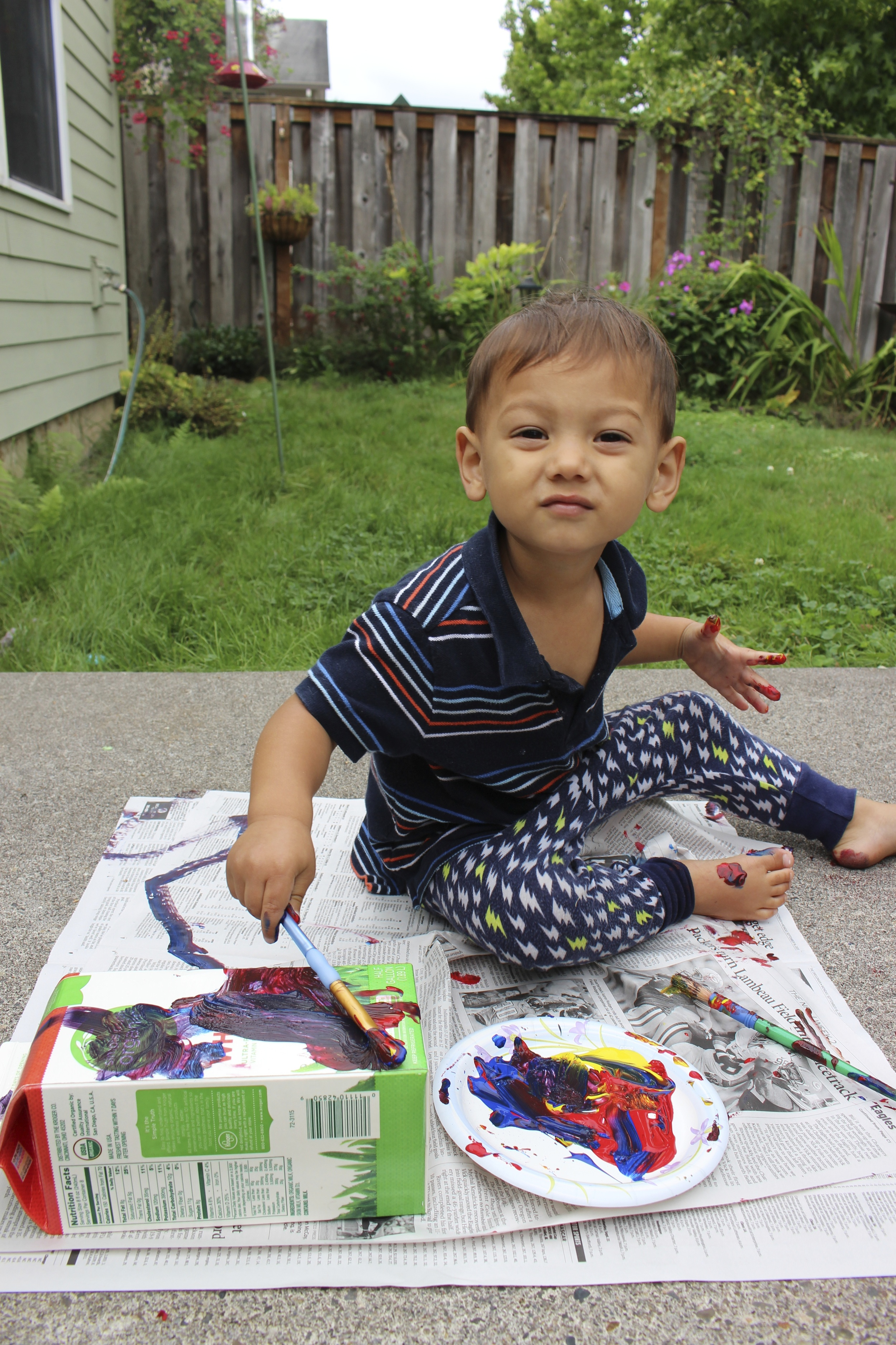 toddler painting outside from IntentionalMama.com.jpg
