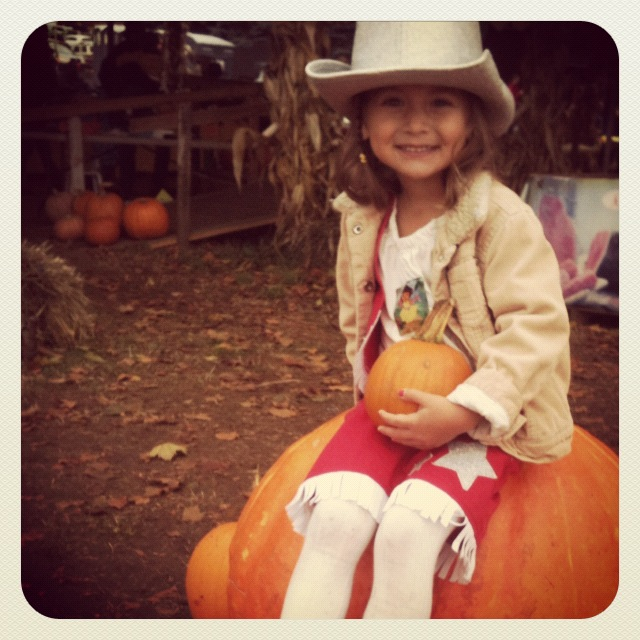 My daughter on last year's annual trip to the Pumpkin Patch