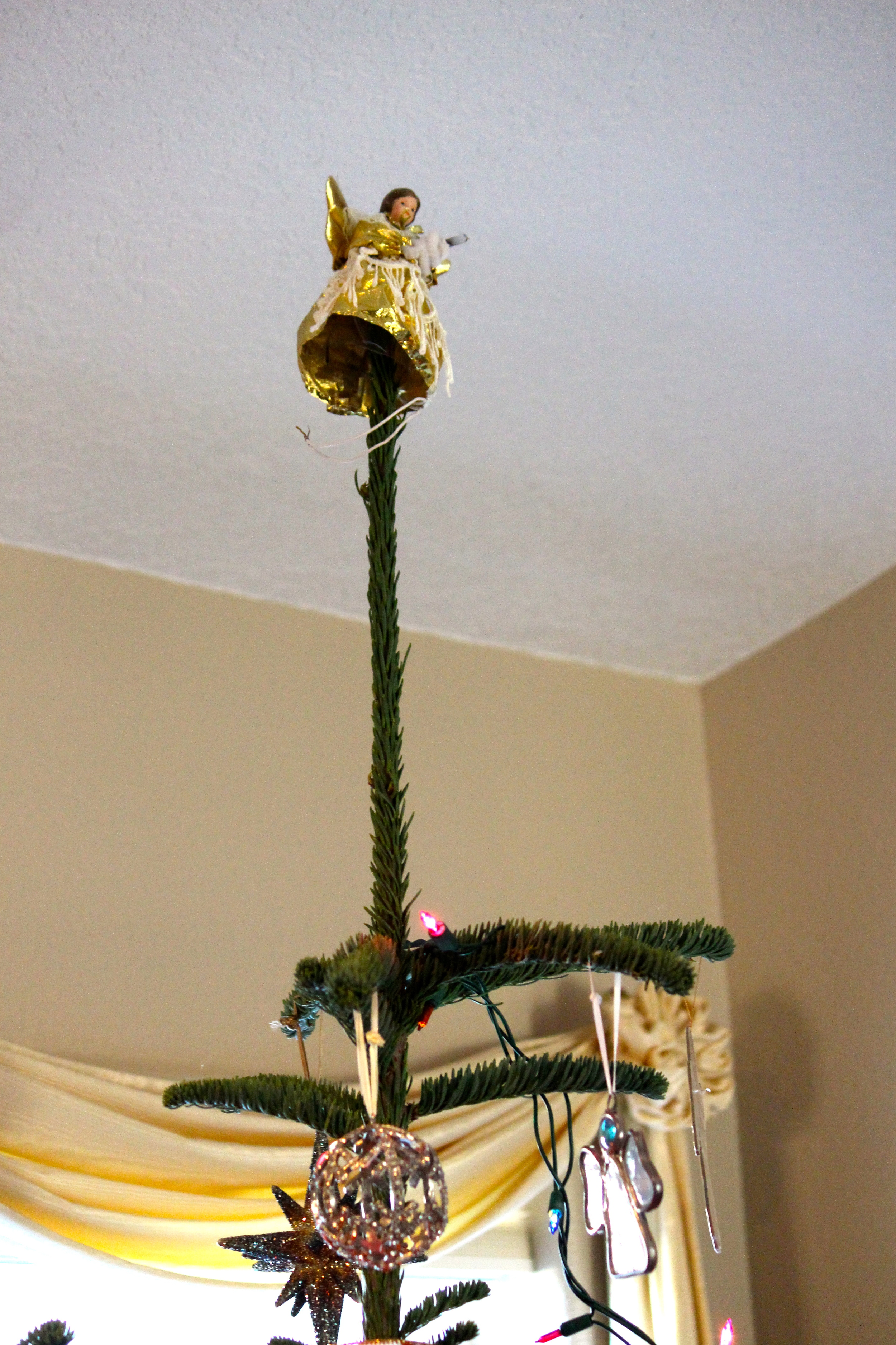 Angel high on tree top Intentional Mama