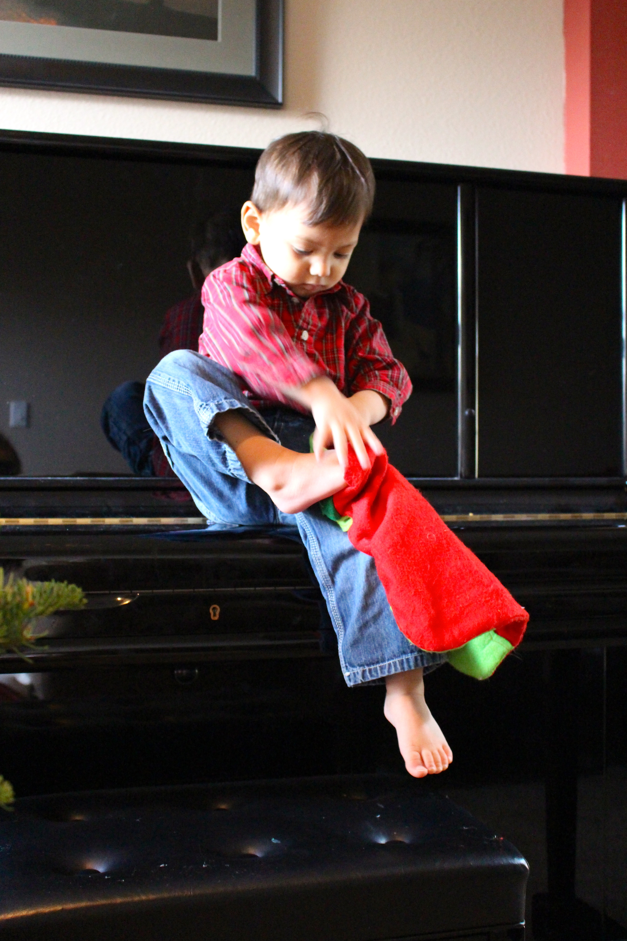 toddler trying on stocking intentional mama