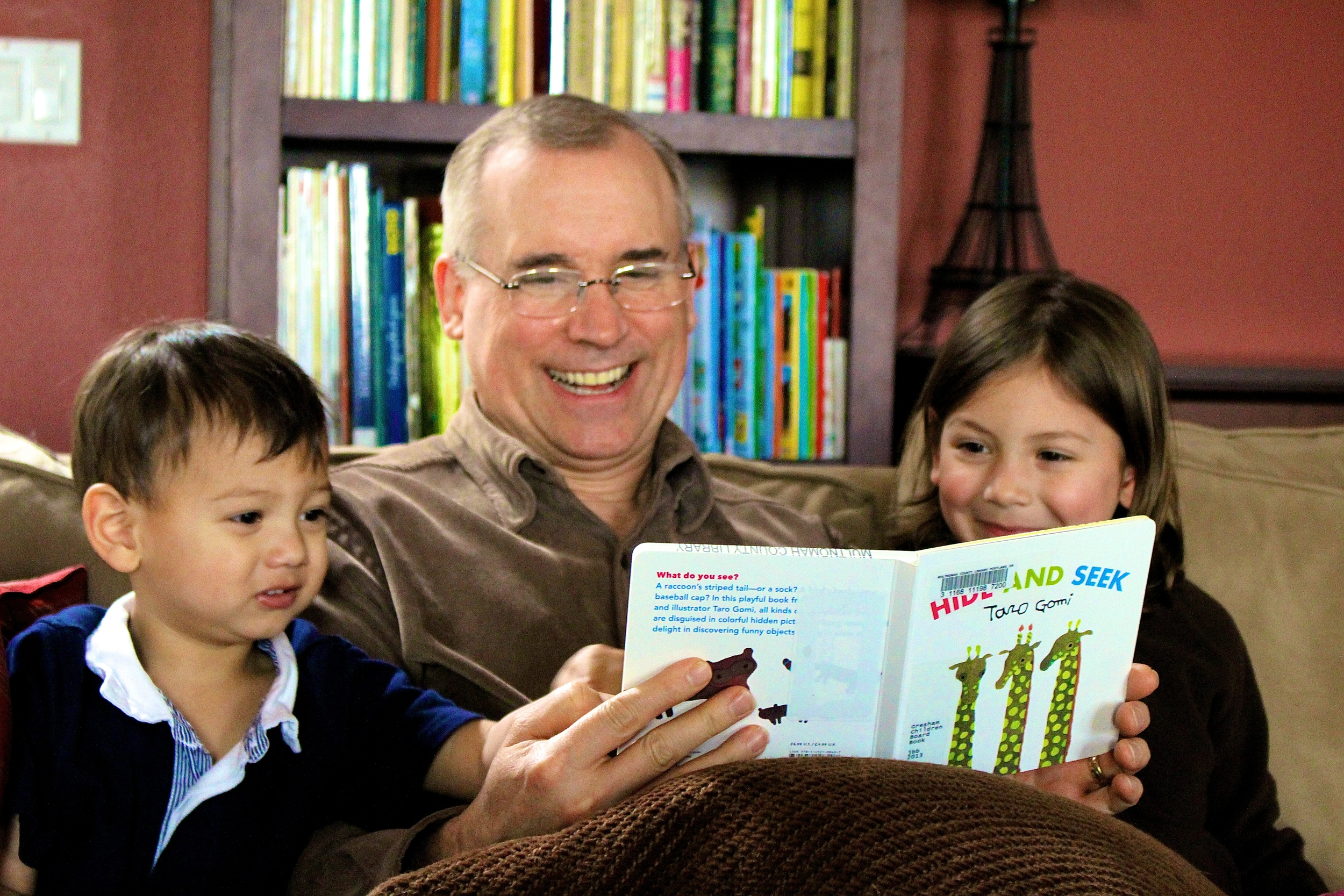 My children reading with their Grandpa