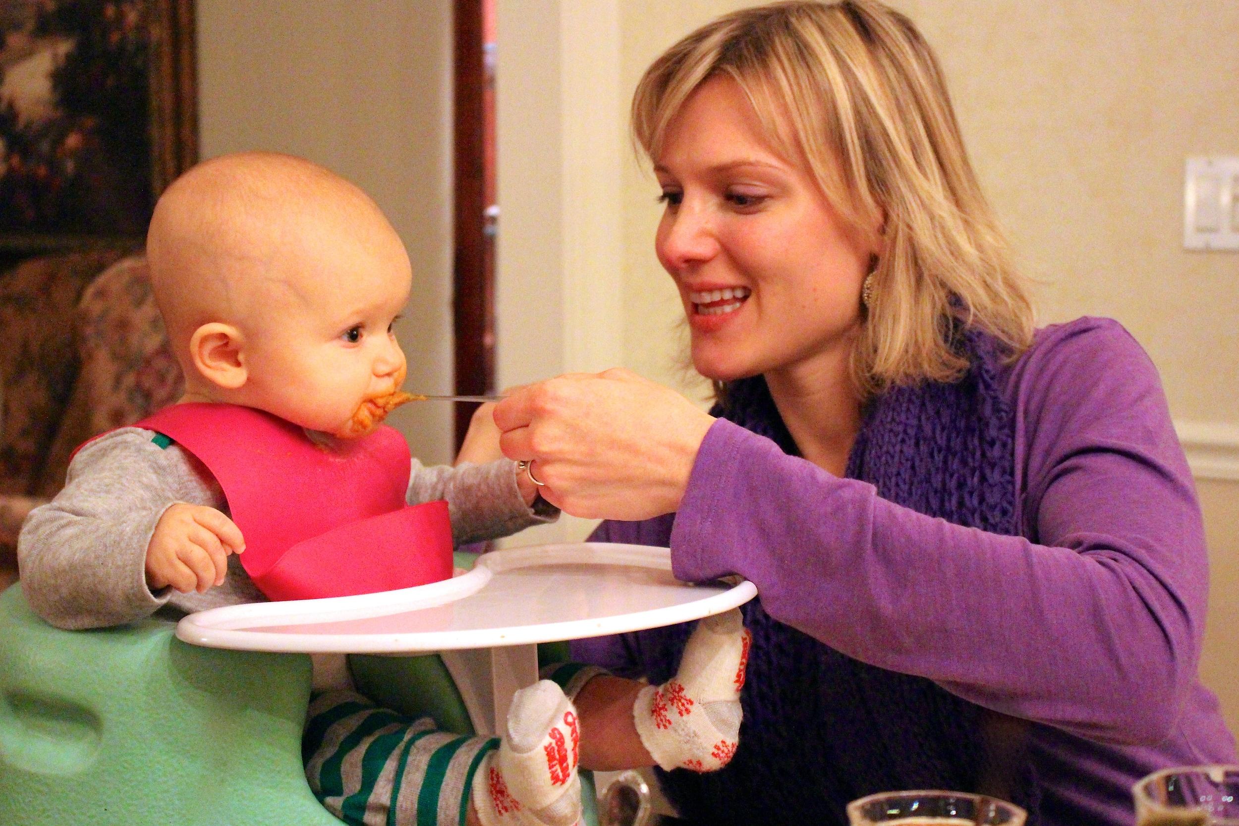 My sister feeding her infant daughter