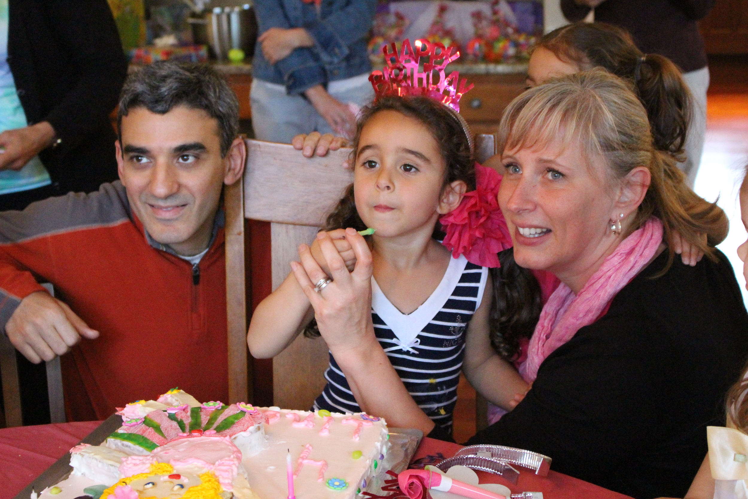 Ihab & Nicole celebrating their daughter's fourth birthday