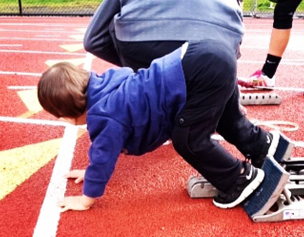 My son learning to use starting blocks