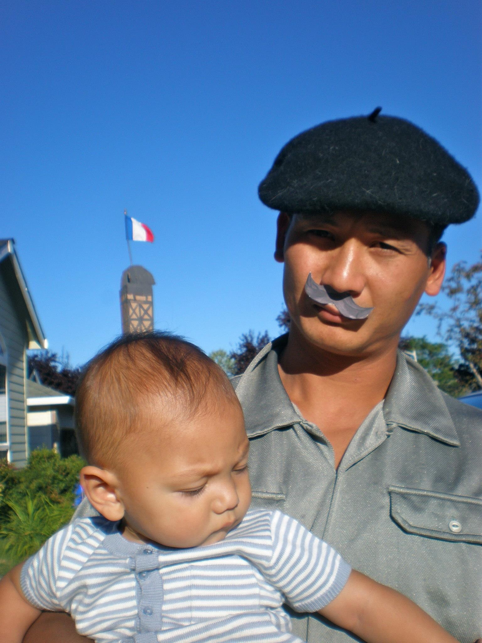 My husband having some French fun with our infant son