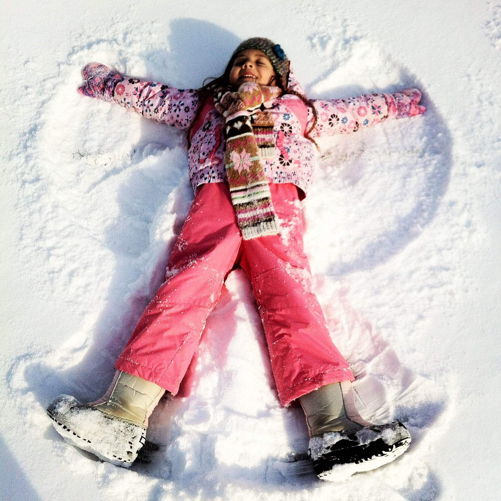 My daughter making a snow angel