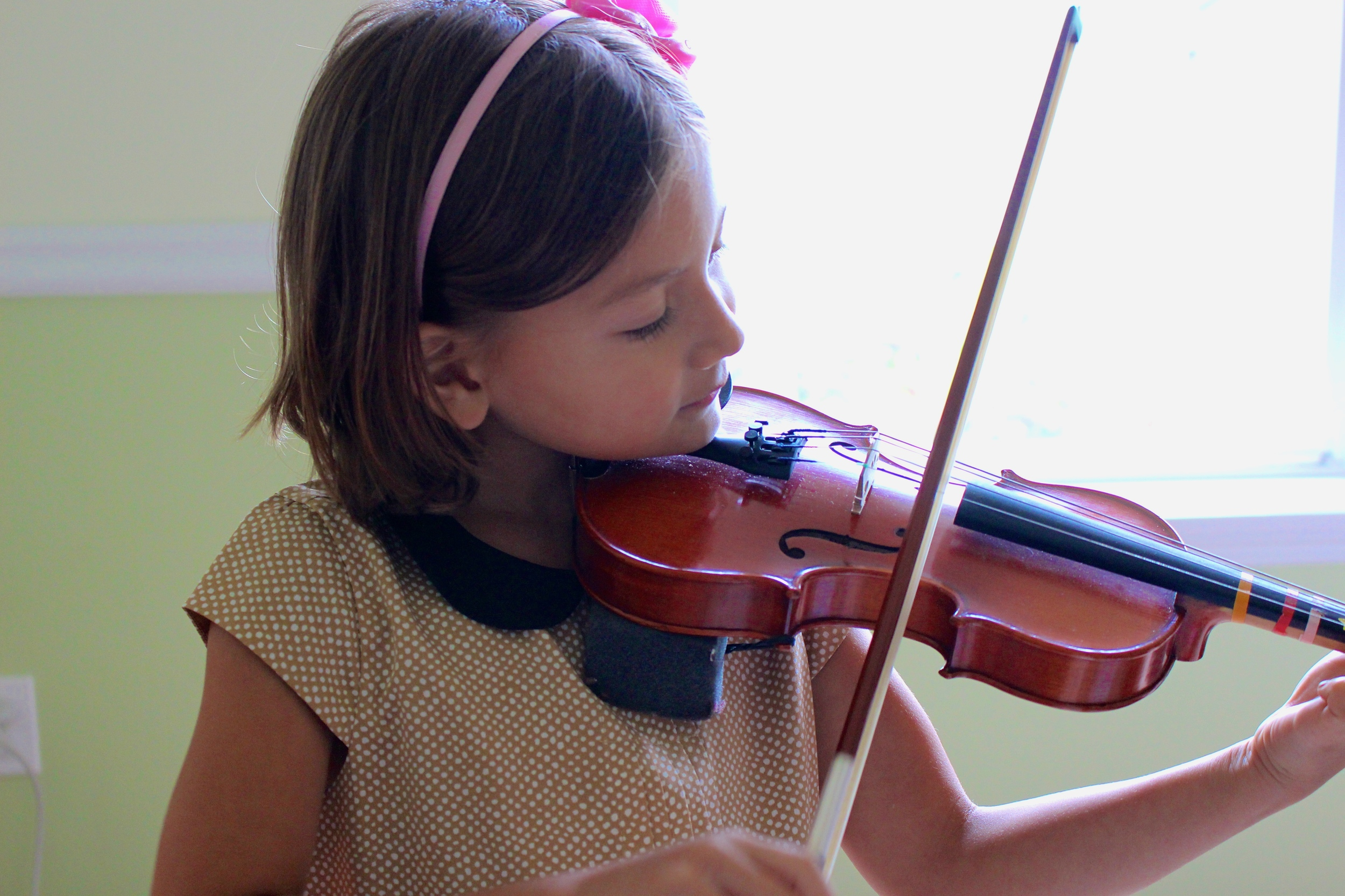 My daughter practicing violin this last month