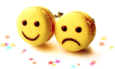 Smiley / frowny macarons via  Dollfoodminatures