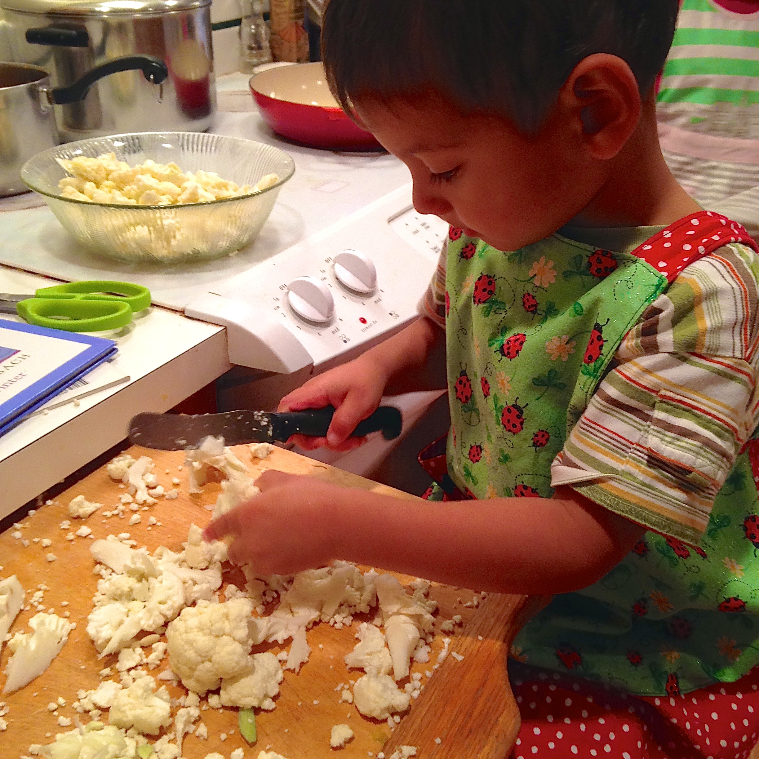 "My son ""helping"" with dinner prep by cutting cauliflower"