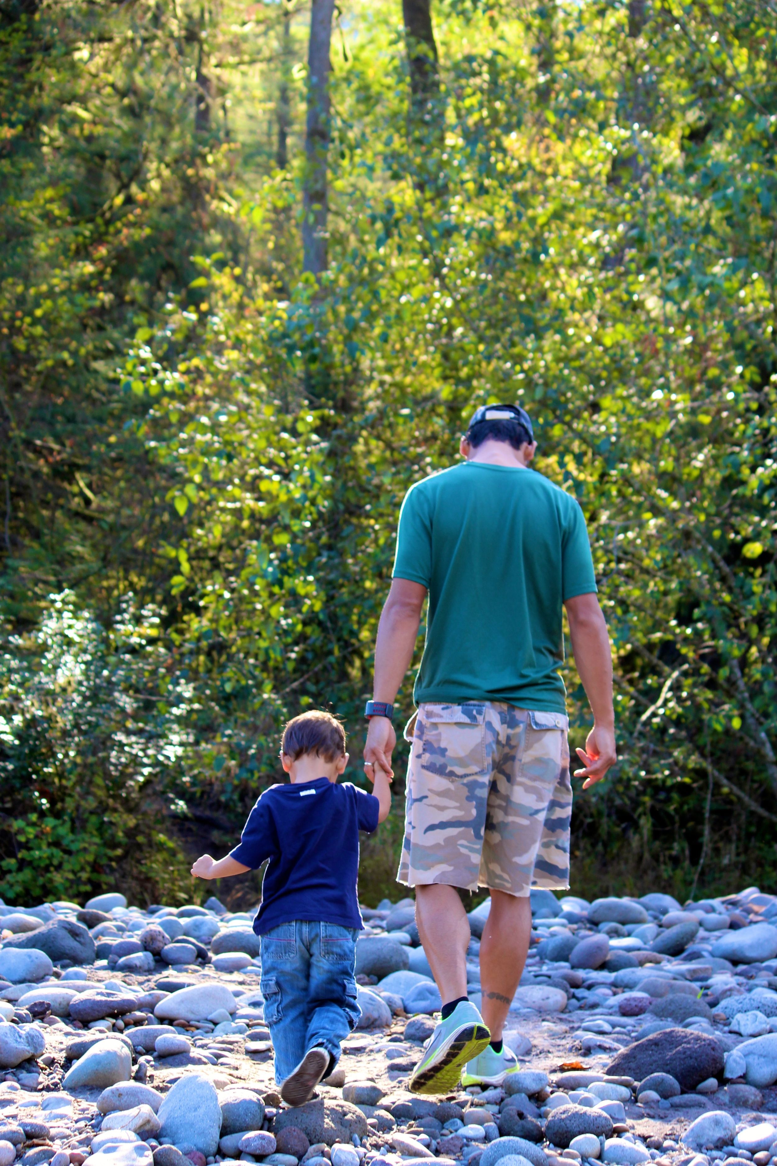 My husband and son walking along the Sandy River