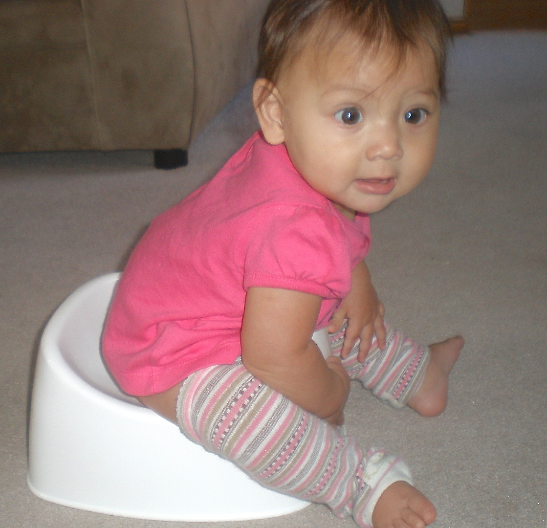 Our five-month-old daughter on a Baby Bjorn potty
