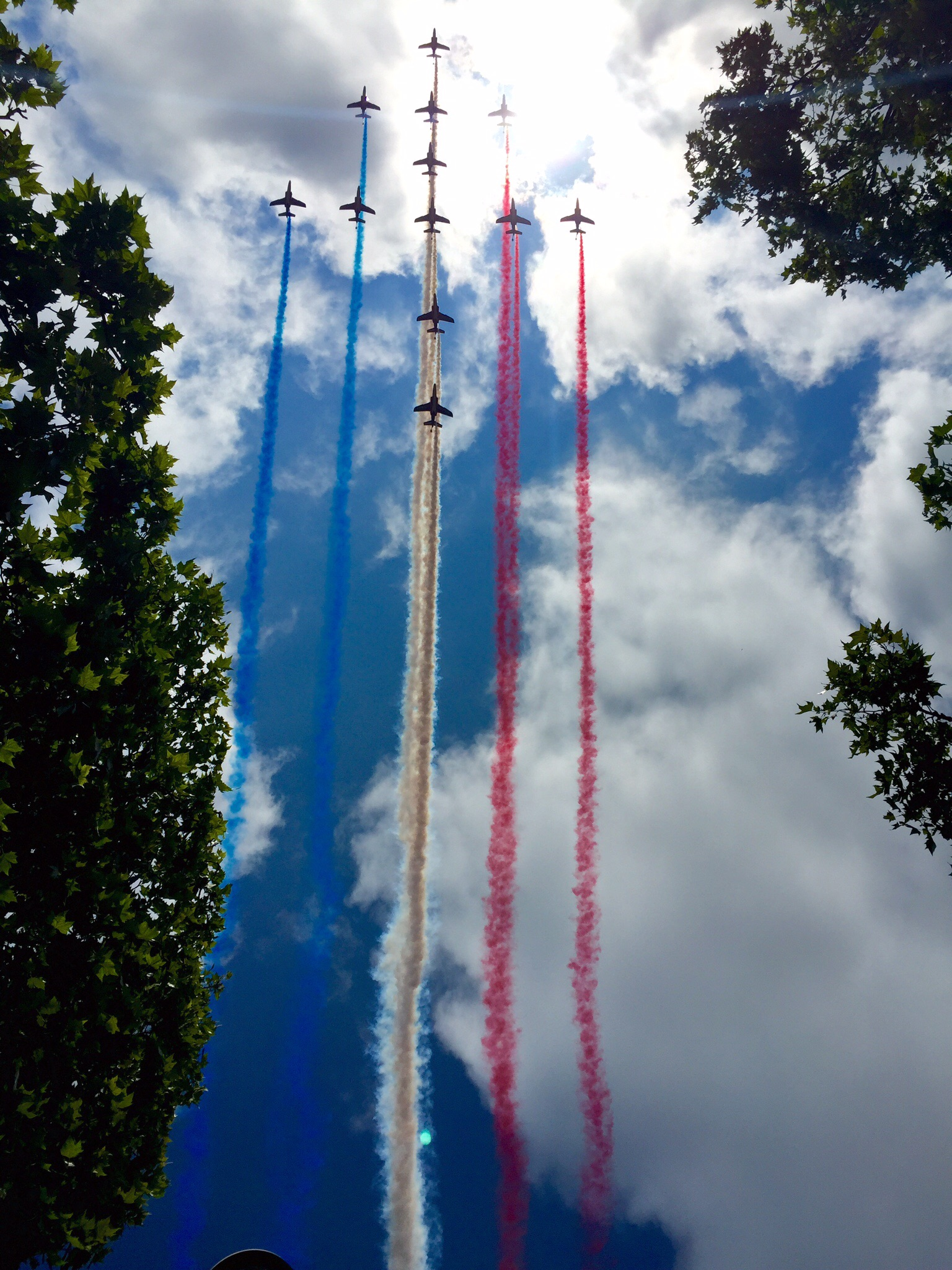 French jets flying over the Champs Elysées on Bastille Day    Bottom Line:  Arrive super early at the eastern end of the Champs Elysées near Clemenceau.