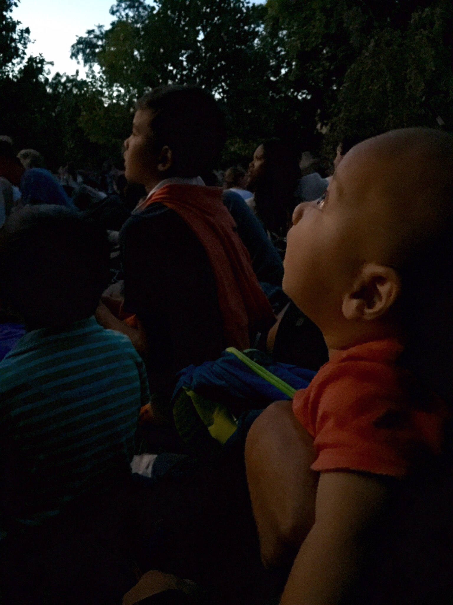 Our infant son watching the tower sparkle during the concert. He slept through the fireworks show, which didn't start until 11pm.