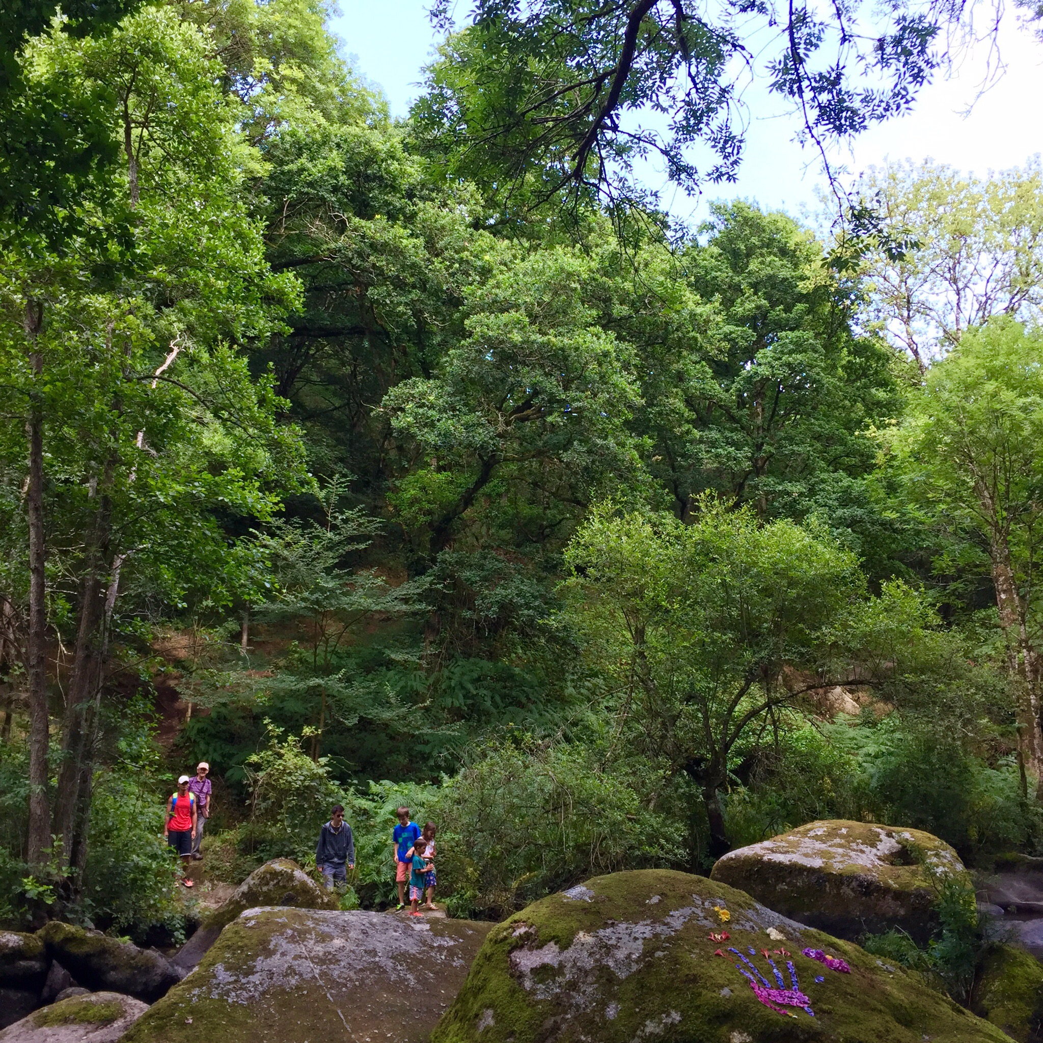 My husband, kids, and family hiking among the rocks in Brittany