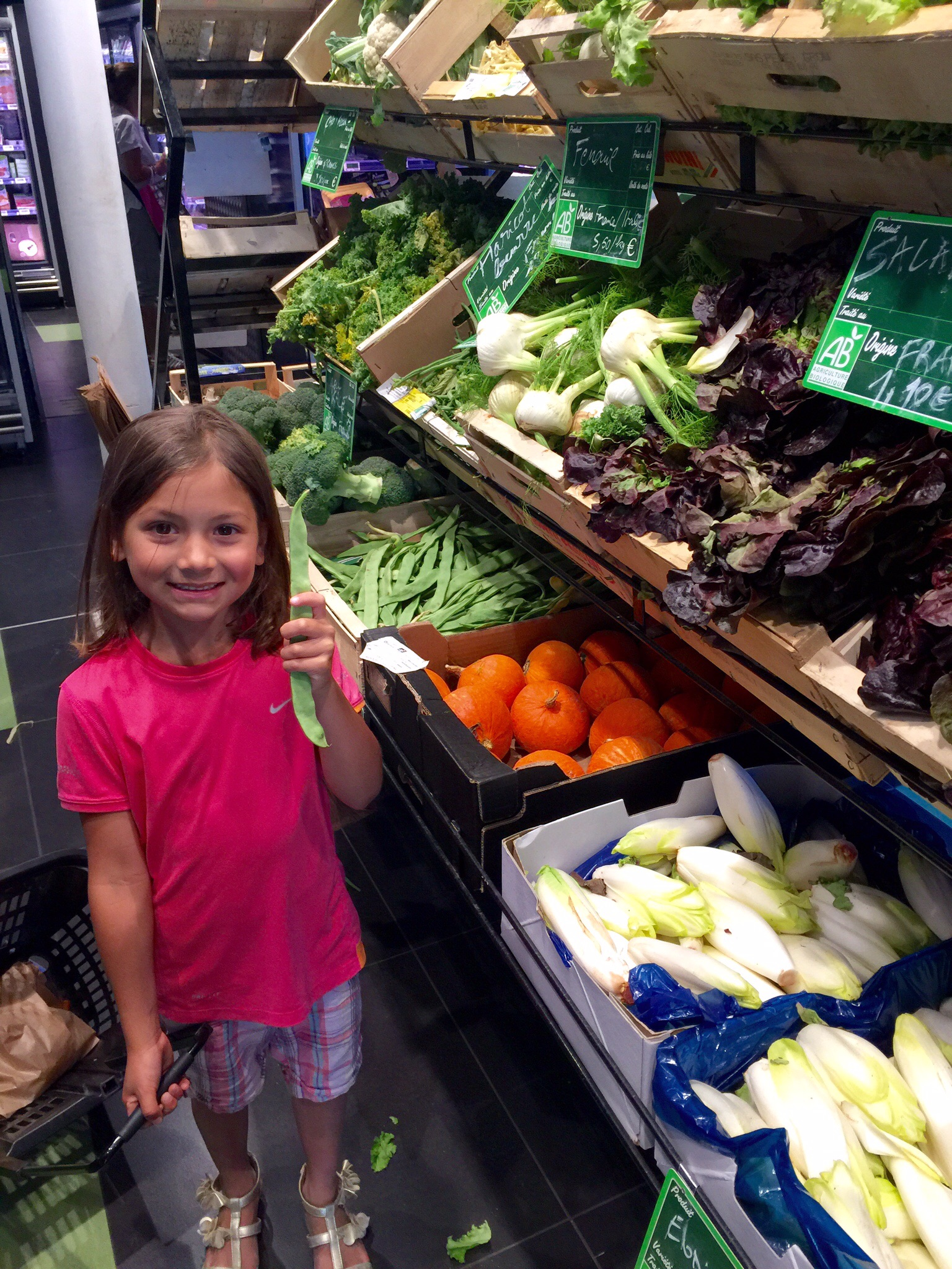 My daughter at  Bio C' Bon , an excellent organic grocery chain in Paris