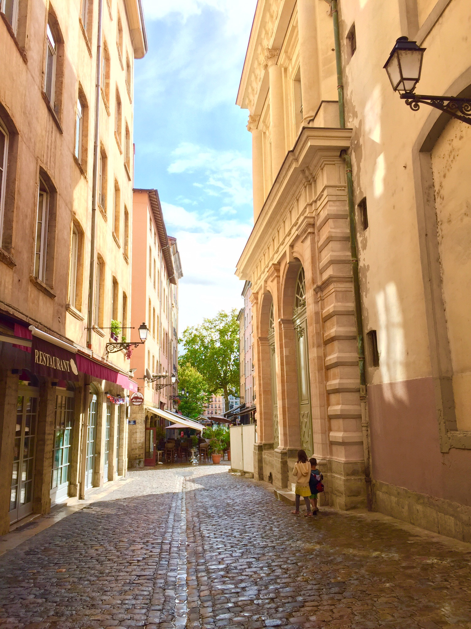 My children walking the cobbled streets of Vieux Lyon, France