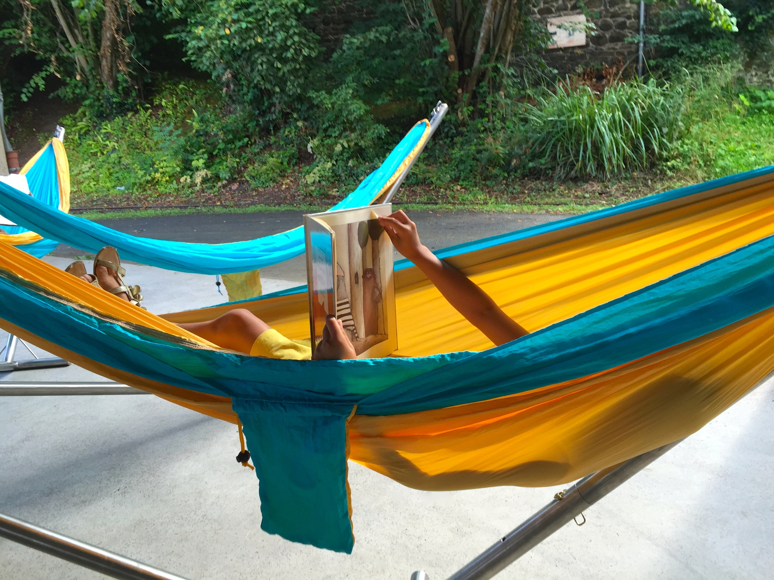 My daughter enjoying the traveling library's hammock