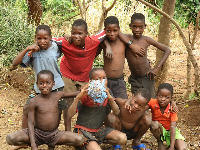Children playing with a ball made of plastic bags & string as Gilbert did before Compassion provided him and his friends with a real soccer ball (photo by  Firesika )