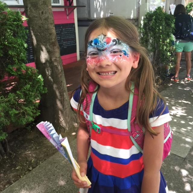 My daughter on Bastille Day in Portland this summer