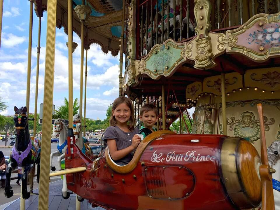My children on le Carrousel de la Tour Eiffel, summer 2015
