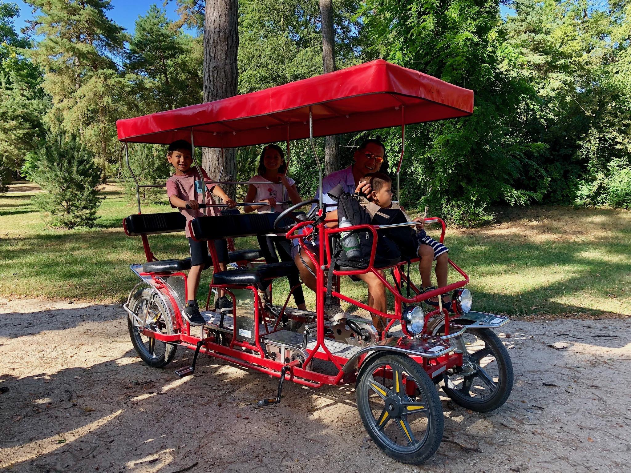 Ceci est une rosalie - Riding our rented pedal bike cart at the Parc Floral, Paris