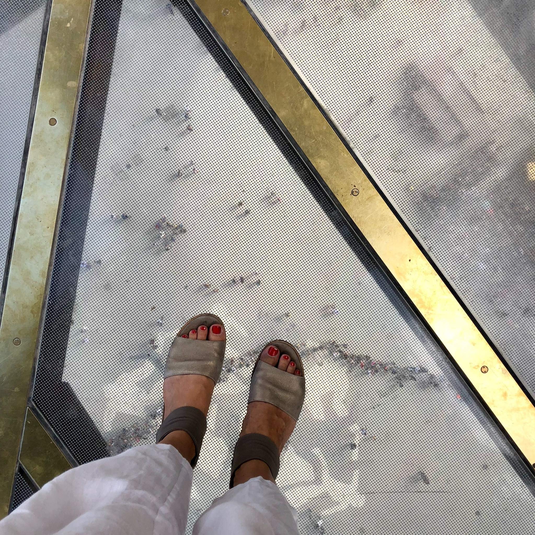 Walking on glass floors, 18 stories up on the first level of the Eiffel Tower
