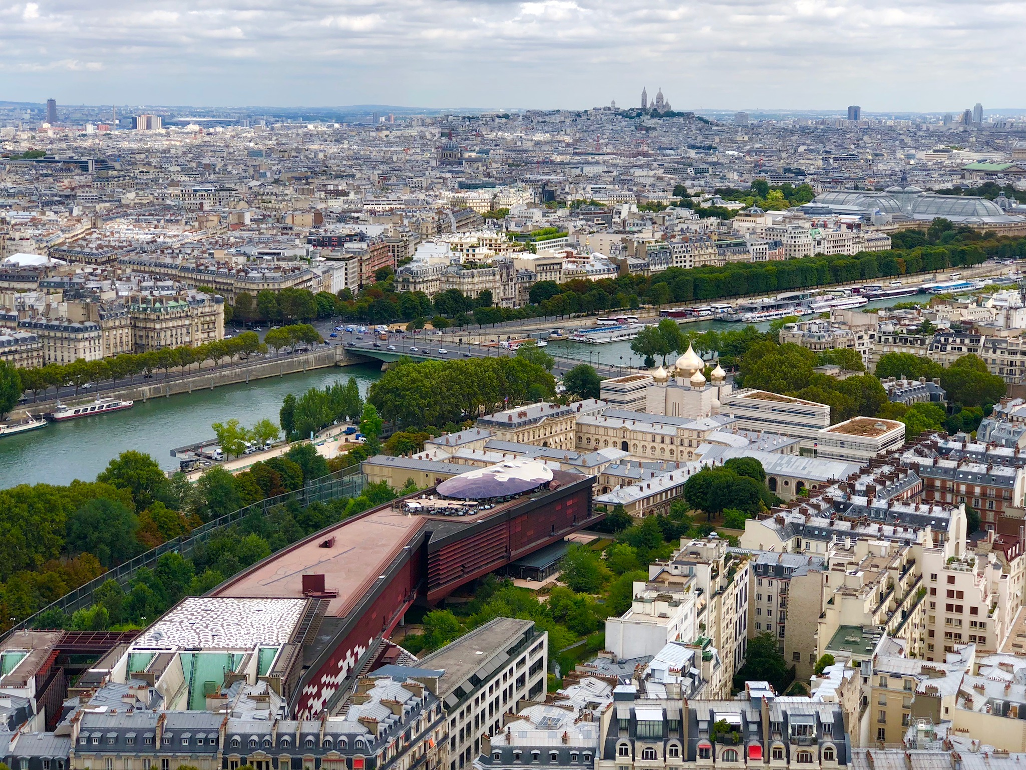 Paris viewed from the Eiffel Tower's second floor, with the Musée du Quai Branly, Russian Orthodox Center, & Sacre Coeur in the distance