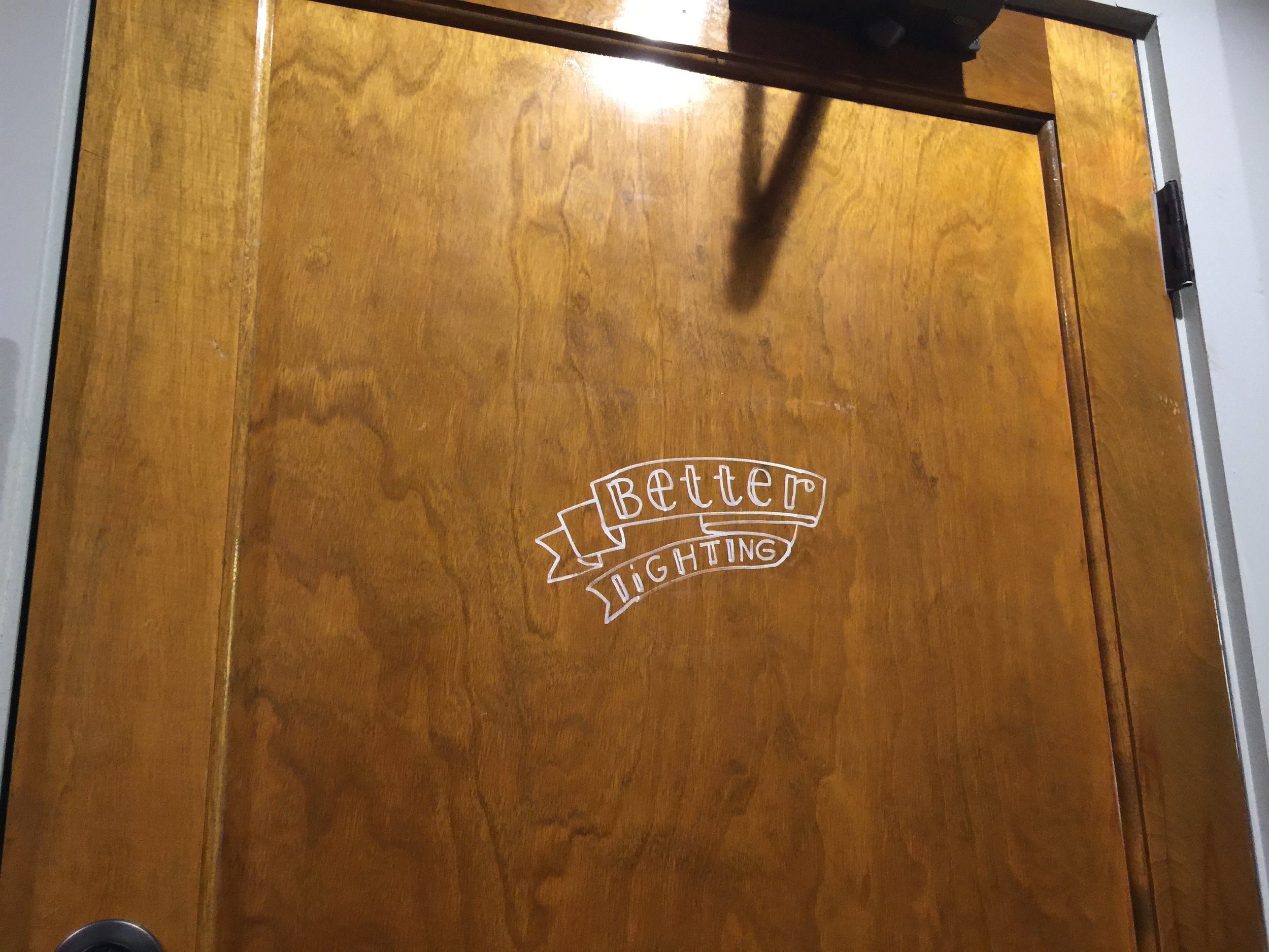 "Restroom sign. ""Better lighting""."