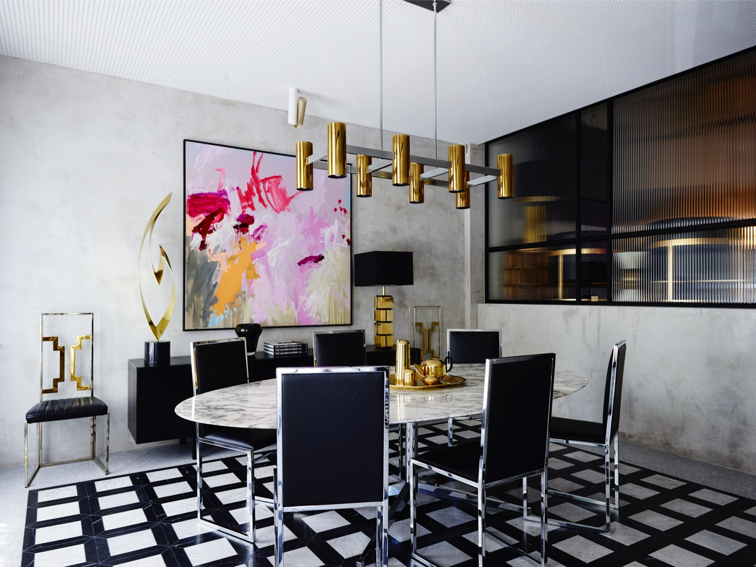 A glint of metal goes a long way. These silver, shiny dining chairs serve up pure, dazzling lines in this room.