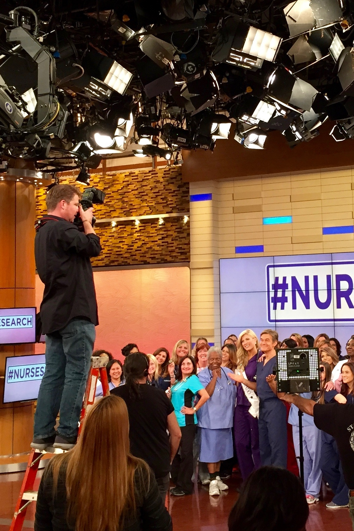 That's me on the ladder getting a large group shot with Dr. Oz and nurses during the nurses search.