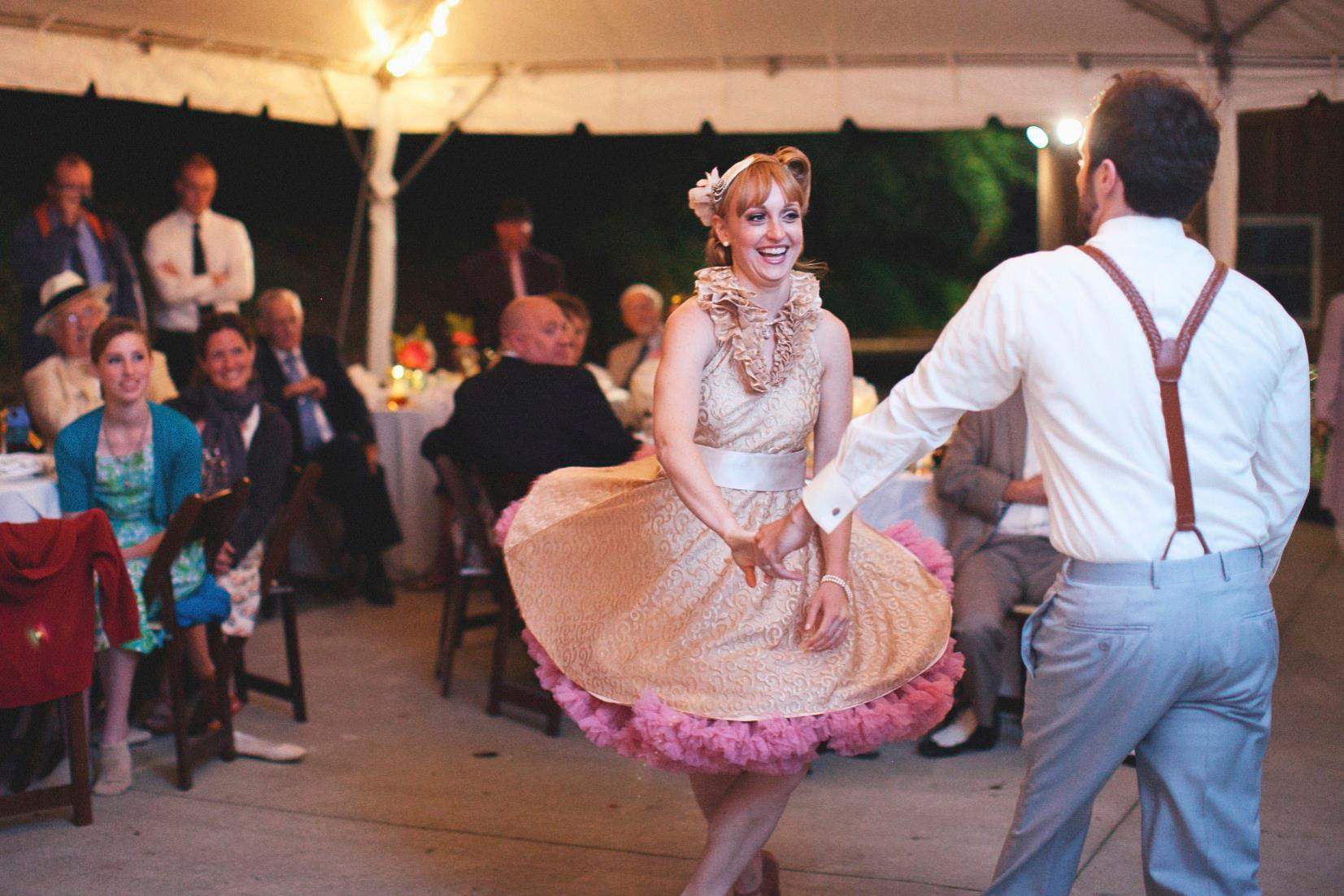 """Dan and Amanda, students of Duet Dance Studio, did a fun swing dance routine to their first dance song, """"Cheek to Cheek"""" at their wedding. Photo by  Love Is A Big Deal."""